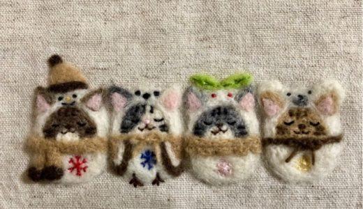 【冬の額飾り】真っ白なぽかぽか温か着ぐるみのねこちゃん・羊毛フェルト刺しゅう